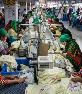 Factory hall garments factory, women sowing